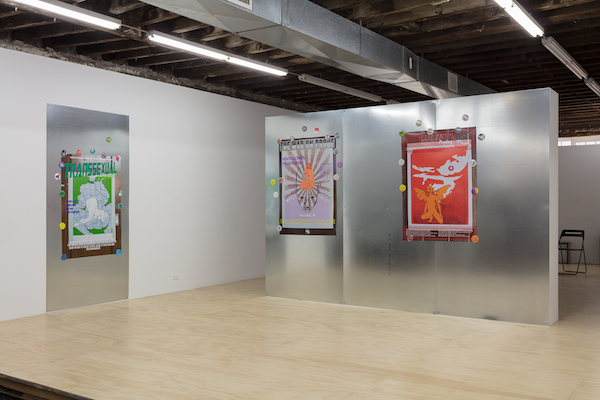 installation image of posters on metallic walls