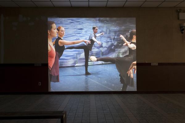 video of artist dancing ballet with ballet dancers