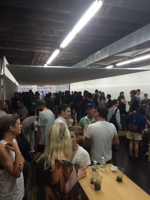 image of a crowd of people drinking and socializing under lowered ceiling