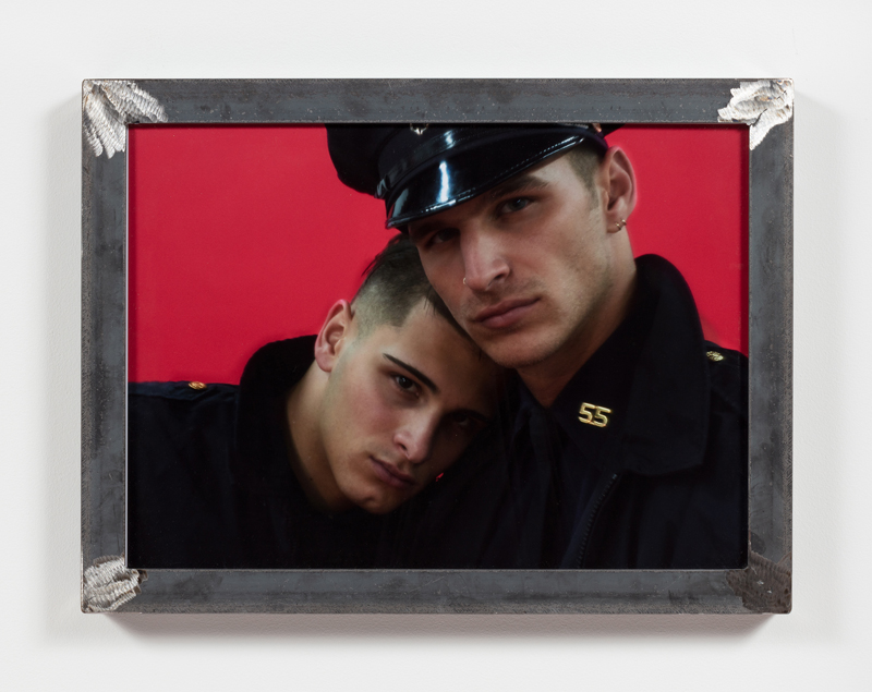 image of two cops nestling against each other in metal frame