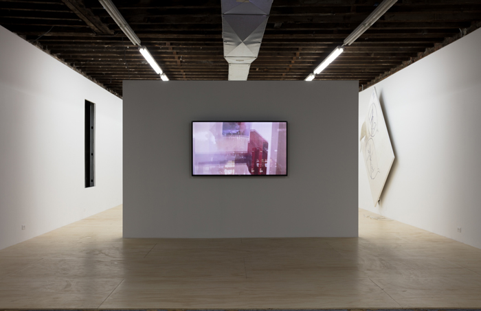 installation image of video work documenting iphone photos