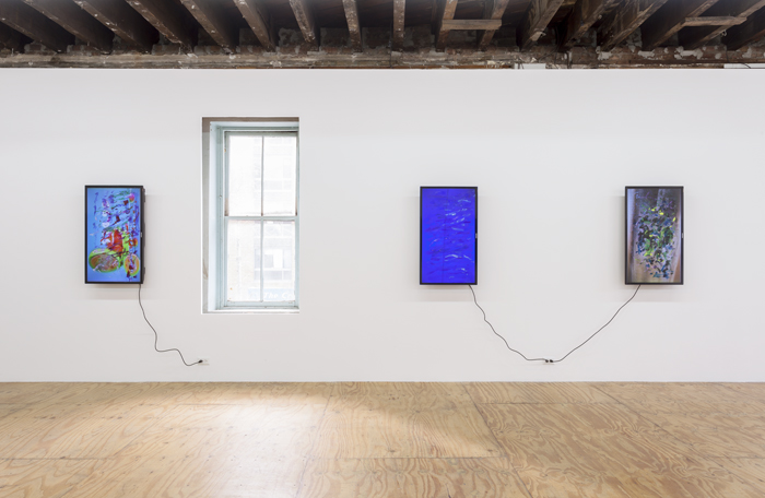 installation shot of three screens with paintstrokes on surface