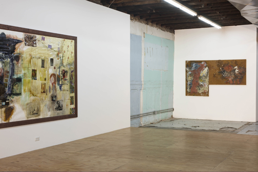installation shot of corner of gallery with two works
