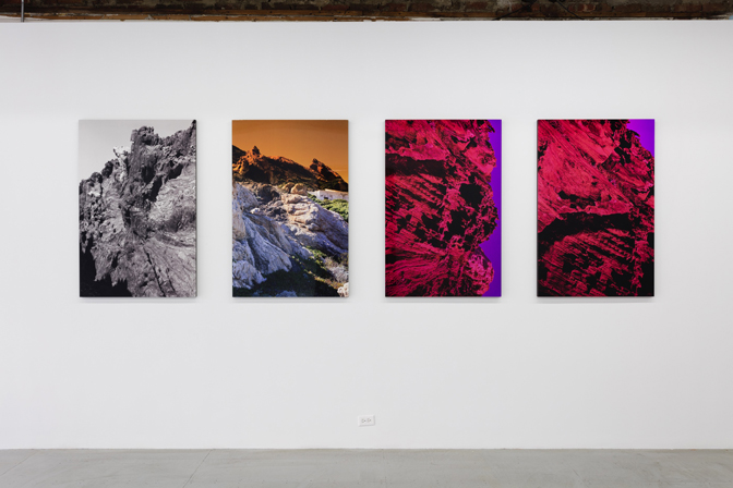 installation shot of Josephine Pryde photos of psychedelic mountains