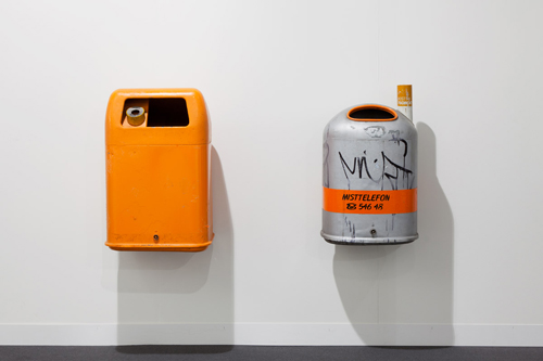 installation image of two trashcans on the wall