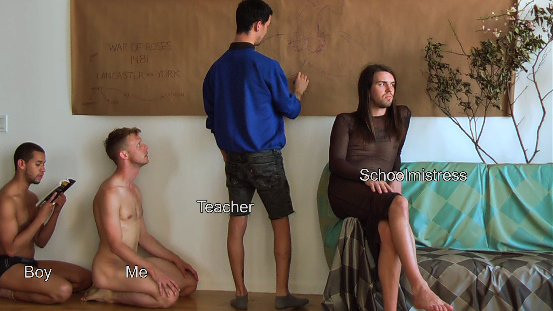 video still of a cast of characters including Boy, Me, Teacher, and Schoolmistress