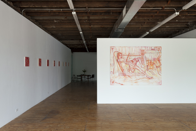 installation image of red paintings