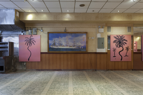 paintings of palm trees on red-pink backgrounds in a vacated Chinese restaurant